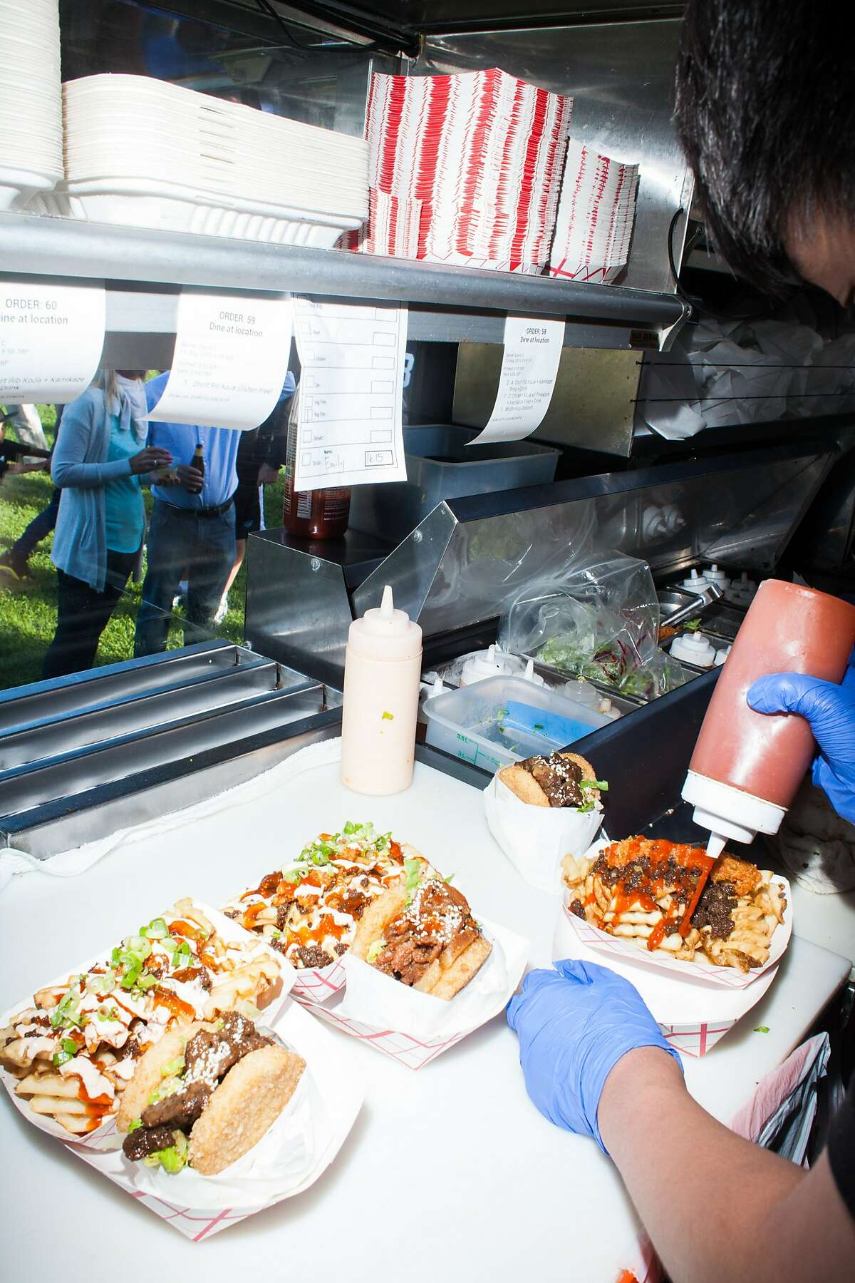 Orders ready to be served in the KoJa Kitchen food truck in San Francisco, Calif., on Thursday, August 13, 2015.