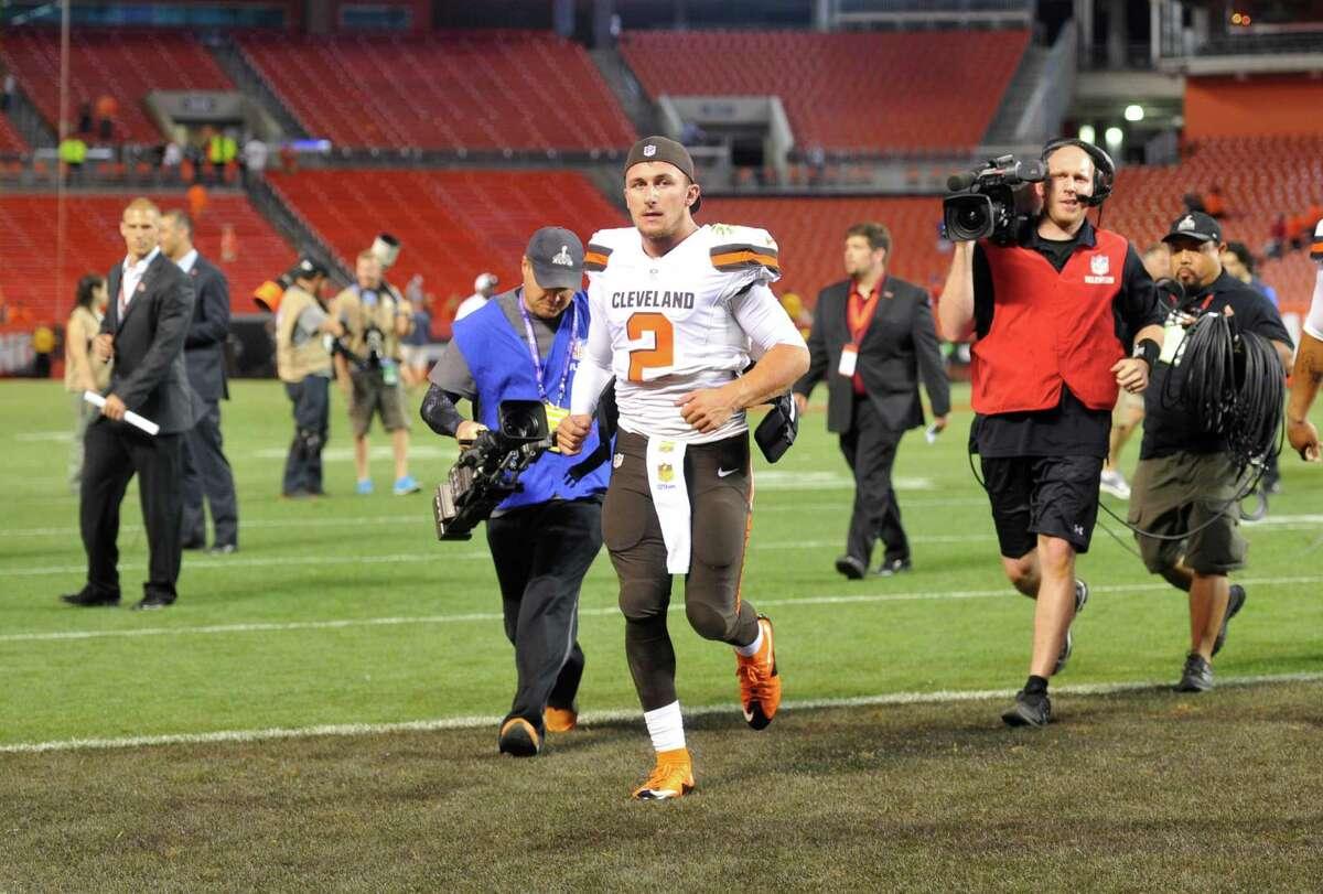 Cleveland Browns quarterback Johnny Manziel (2) runs off the field after an NFL preseason football game against the Buffalo Bills Thursday, Aug. 20, 2015, in Cleveland. Buffalo won 11-10.