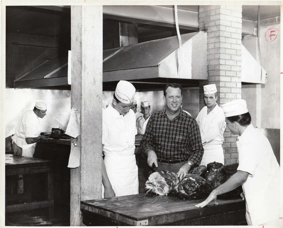 Leonard McNeill at pits at 5420 Harrisburg location circa 1960. / handout