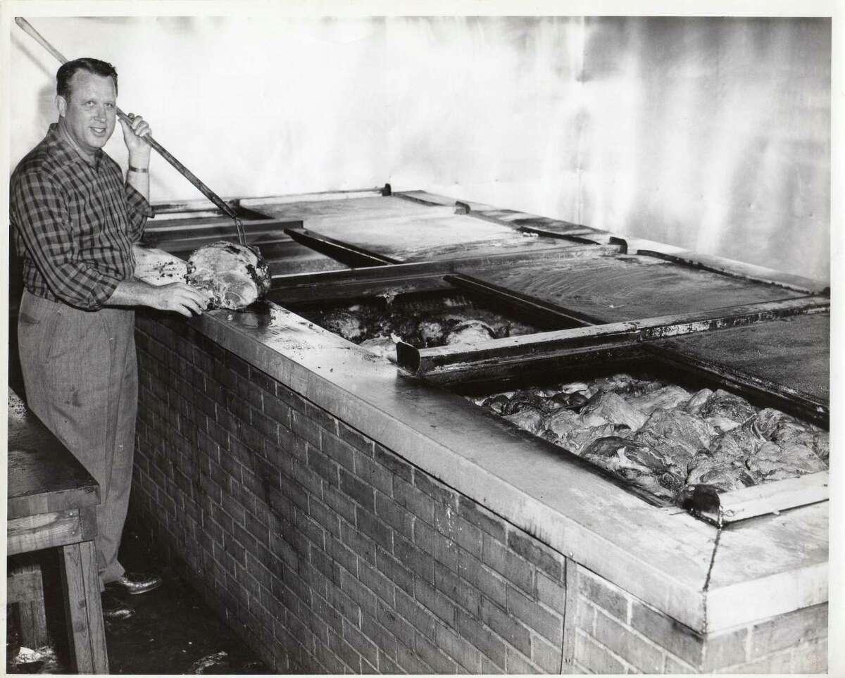 Leonard McNeill at pits at 5420 Harrisburg location circa 1960.