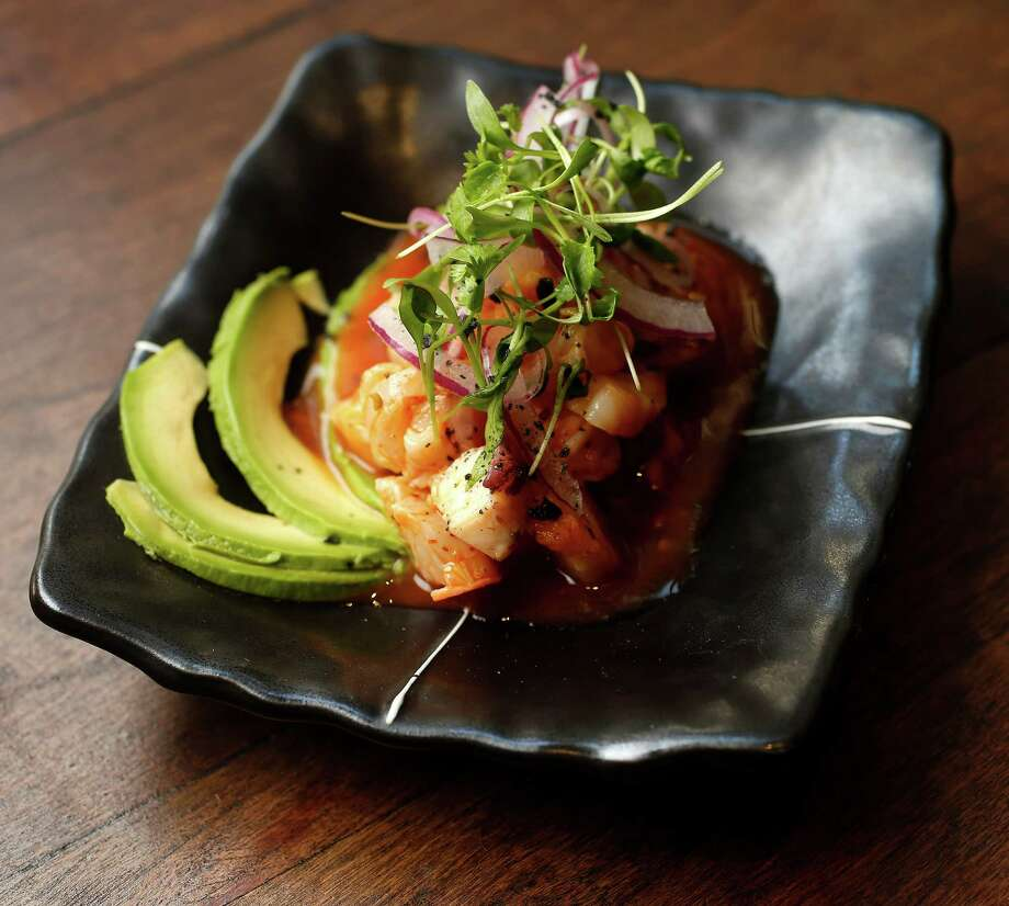 The Vuelve a la Vida; Japanese snapper, gulf fish, octopus and Japanese bay scallops in a yuzu and sriracha hot sauce with avocado, red onions and crushed sea salt at Izakaya, 318 Gray, at the corner of Gray and Bagby, on Thursday, July 23, 2015, in Houston. ( Karen Warren / Houston Chronicle ) Photo: Karen Warren, Staff / © 2015 Houston Chronicle