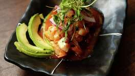 The Vuelve a la Vida; Japanese snapper, gulf fish, octopus and Japanese bay scallops in a yuzu and sriracha hot sauce with avocado, red onions and crushed sea salt at Izakaya, 318 Gray, at the corner of Gray and Bagby, on Thursday, July 23, 2015, in Houston. ( Karen Warren / Houston Chronicle )