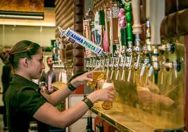 Bartender Maritza Rocha pours two beers at Dirty Water in San Francisco, Calif., on August 20th, 2015.