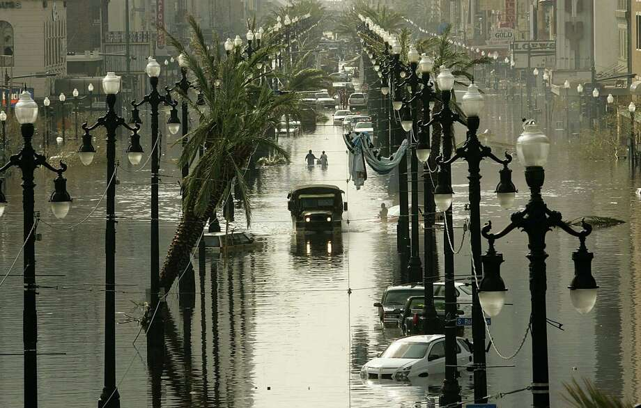 A military truck drives down a flooded Canal Street. Photo: Mark Wilson, Getty Images / Getty Images North America