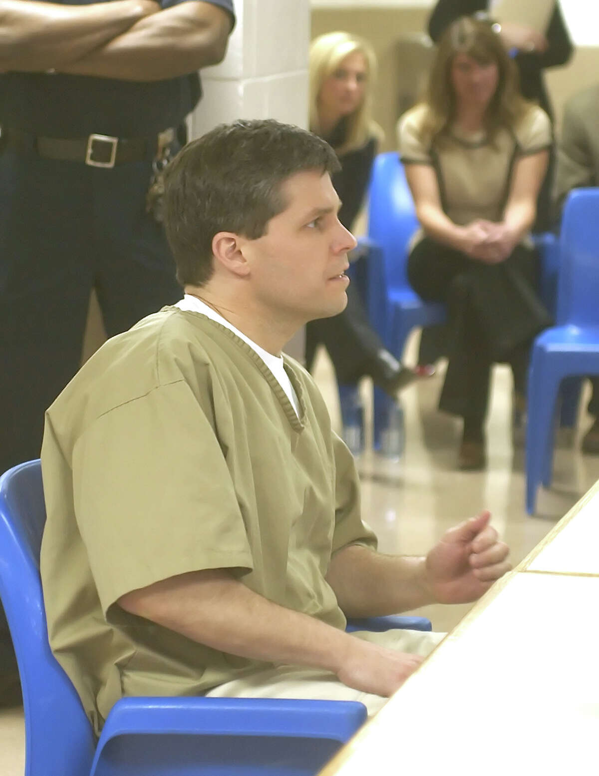 Alex Kelly reacts after he was informed that his request for parole had been denied by the state parole board at a hearing in Suffield, Conn., Thursday, March 3, 2005, as Adrienne Bak, left background, and Hillary Buchanan, right background, listen. Kelly was convicted in 1997 of raping both Bak and Buchanan in 1986. (AP Photo/Bob Child, Pool)
