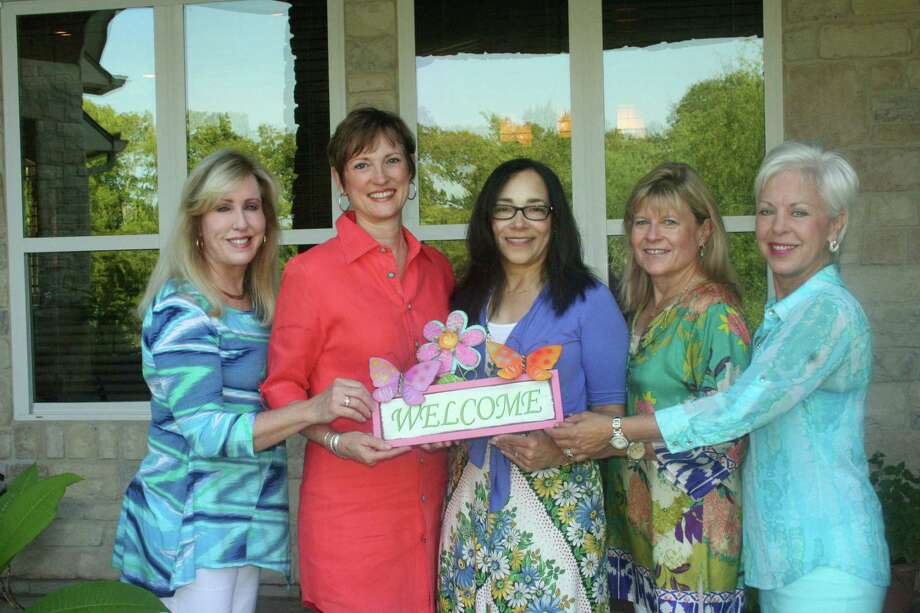 The welcome mat was out!  Greeting current and prospective members at the Aug. 11 coffee were, from left, Liz Furman, President Kelli Mentzenthin, Dorine Craig, CeeCee Parker, hostess, and Mary Favre. Photo: Joan Vogan / For The Chronicle