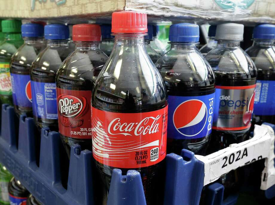 Reasons that the majority of people in the United States now drink soda excessively and on a daily basis are that soda is cheap, comes in all shapes, sizes, and colors, is sold on every street corner and is served in hospitals, schools and churches. Photo: Rich Pedroncelli /Associated Press / AP
