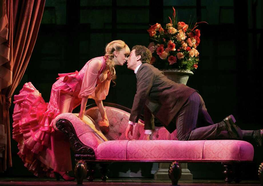 "Lisa O'Hare, left, and Bryce Pinkham performing in ""A Gentleman's Guide to Love and Murder,"" at the Walter Kerr Theater in New York, Oct. 21, 2013. The musical is a rare transformation of Alec Guiness's movie classic, ""Kind Hearts and Coronets,"" which introduces a conniving killer who turns murder into entertainment. (Sara Krulwich/The New York Times) Photo: SARA KRULWICH, STF / NYTNS"