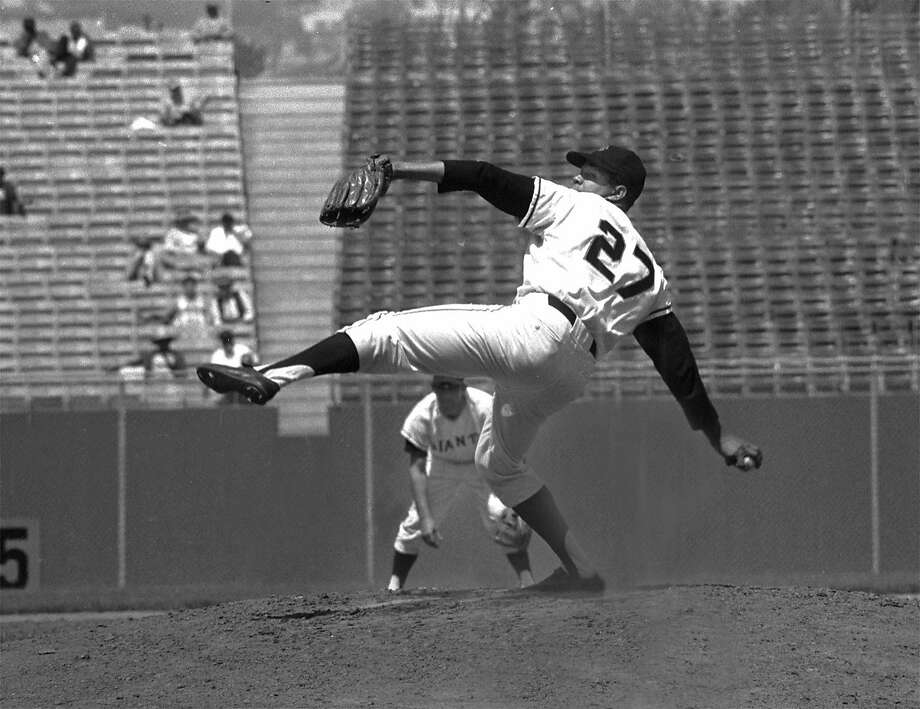 Giants righthander Juan Marichal goes high with his left foot in his wind-up on the mound against the Houston Astros on Sept. 9, 1965, at Candlestick Park in San Francisco. This was his first game back after a suspension for hitting Dodgers catcher John Roseboro with a bat. Photo: Associated Press, 1965
