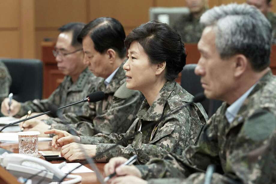 "South Korean President Park Geun-hye, second from right, presides over a security meeting to check South Korea's military readiness against the North Korea's military attack at the headquarters of Third Army in Yongin, South Korea, Friday, Aug. 21, 2015. North Korean leader Kim Jong Un on Friday declared his frontline troops in a ""quasi-state of war"" and ordered them to prepare for battle a day after the most serious confrontation between the rivals in years.  (Baek Seung-ryul/Yonhap via AP) KOREA OUT Photo: Baek Seung-ryul, SUB / Yonhap"