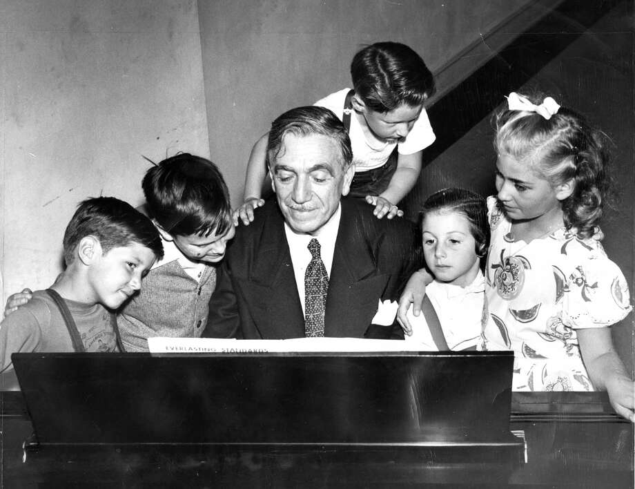 Gaetano Merola on piano accompanies young singers from the Telegraph Hill Neighborhood Association, Charles Allshouse (left), Roque Castro, Robert Tomi, Antoinette Mongi and La Deana Caravelli in 1947. / ONLINE_YES