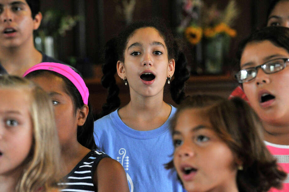 Lindsay Rosario practices her singing with the choir during the Native Instrument Academy Summer Camp at the Unitarian-Universalist Church in downtown Stamford, Conn., on Friday, Aug. 21, 2015. On Sunday, campers will join with multiple generations of their family and members of the community to take part in the Grand Community Choir at 4 p.m. as part of the Summer Fiesta Festival. The festival runs from 12 to 7 p.m. at Domus, 83 Lockwood Avenue, and features games, attractions, food and guest artists performing live music. Photo: Jason Rearick / Hearst Connecticut Media / Stamford Advocate