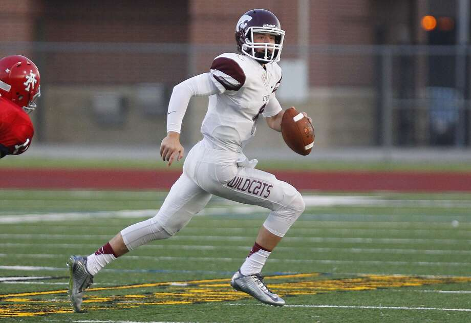 Clear Creek quarterback Chase Hildreth scrambles looking for an open receiver as they took on Alief Taylor at Crump Stadium in Alief on September 5, 2014. Photo: Diana L. Porter, Freelance / © Diana L. Porter