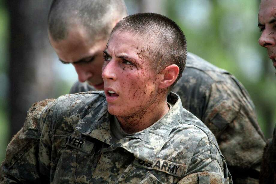 In this April 26, 2015, photo, 1st Lt. Shaye Haver, one of the 20 female soldiers, who is among the 400 students who qualified to start Ranger School, tackles the Darby Queen obstacle course, one of the toughest obstacle courses in U.S. Army training, at Fort Benning, in Ga. Haver and Capt. Kristen Griest are the first women to complete the U.S. Army's grueling Ranger School and were scheduled to graduate Friday, Aug. 21, alongside 94 male soldiers at Fort Benning, Ga., families of the soldiers confirmed Wednesday. (Robin Trimarchi/Ledger-Enquirer via AP) Photo: Robin Trimarchi, MBO / Ledger-Enquirer