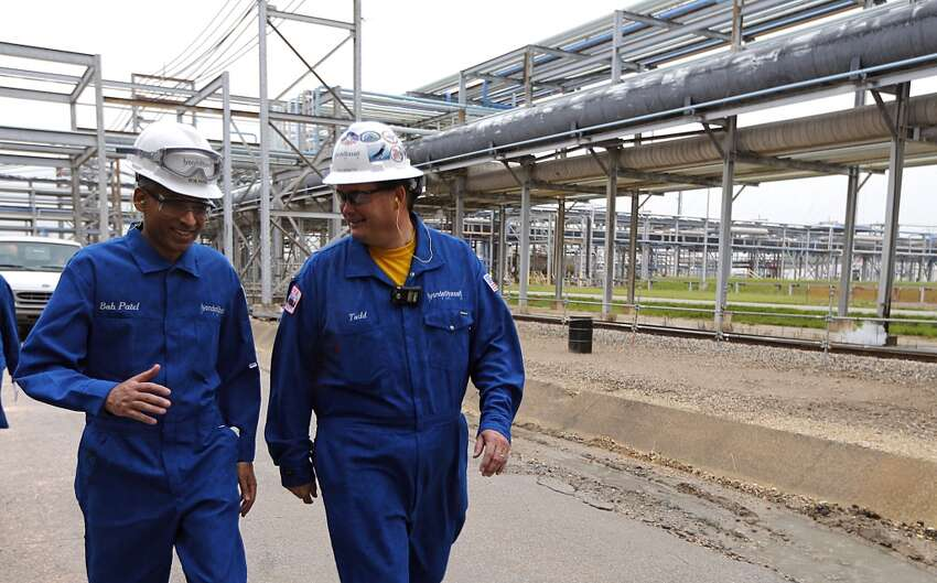 LyondellBasell CEO Bob Patel left, and plant manager Todd Monette right, walk through the Olefins Plant of LyondellBasell Chemical Company during a tour Friday, Aug. 21, 2015, in Channelview. ( James Nielsen / Houston Chronicle )