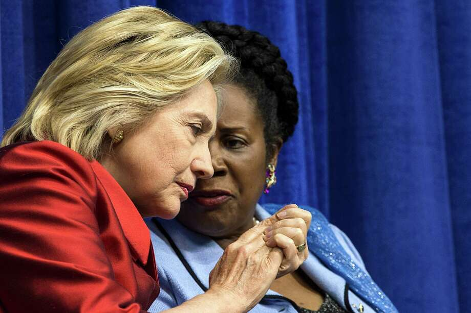 Former Secretary of State Hillary Rodham Clinton and Rep. Sheila Jackson Lee, D-Texas, sit together before Clinton was presented with the Inaugural Barbara Jordan Gold Medallion Leadership Award on the campus of Texas Southern University on Thursday, June 4, 2015, in Houston. ( Brett Coomer / Houston Chronicle ) Photo: Brett Coomer, Staff / © 2015 Houston Chronicle