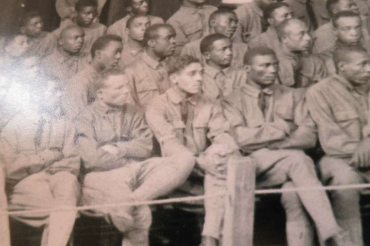 Jesse Moore, middle, first row, listens to testimony that will lead to his execution during the largest court-martial in American military history. A single inexperienced attorney was assigned to defend 63 soldiers.