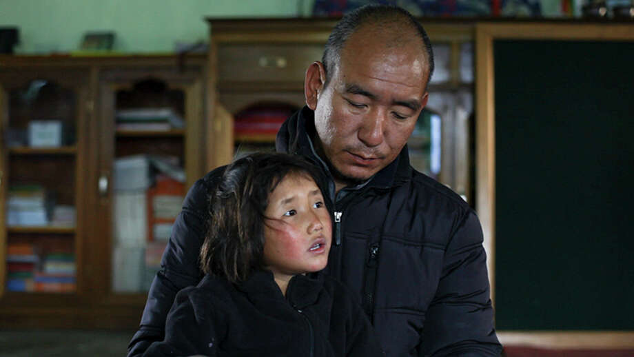 """Buddhist monk Lobsang Phuntsok runs a children's community called Jhamtse Ghatsal in the foothills of the Himalayas. He is featured with 5-year-old Tashi in the documentary """"Tashi and the Monk,"""" airing on HBO through mid-September. Photo: Courtesy Photos /""""Tashi And The Monk"""""""