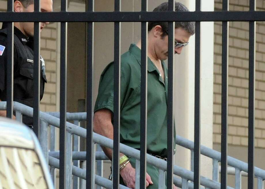 Glendon Scott Crawford is lead out of  the James T. Foley U.S. Courthouse on Friday Aug. 21, 2015 in Albany, N.Y., after a jury convicted Crawford for charges that he built a machine that federal prosecutors contended he bragged could be used to kill Muslim?s and others. (Michael P. Farrell/Times Union) Photo: Michael P. Farrell / 00033081A