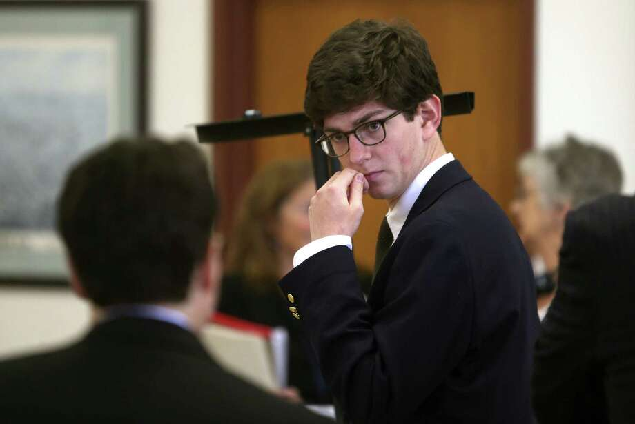 "Former St. Paul's student Owen Labrie confers with his lawyer before his second day of trial in Concord, N.H. Labrie is accused of raping a freshman as part of the ""Senior Salute,"" a practice of sexual conquest.  Photo: Geoff Forester, POOL / Pool Concord Monitor"