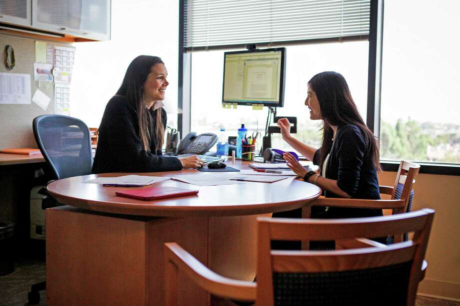 Cack Wilhelm (left) a principal at Scale Venture Partners, and her colleague, associate Rose Yuan evaluate deals at their office in Foster City. Photo: Gabrielle Lurie / Photos By Gabrielle Lurie / Special To The Chronicle / ONLINE_YES