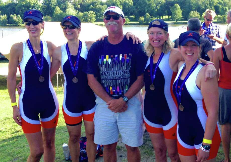 The bronze medal-winning members of the Women's Open C Quad race gather Aug. 13 at US Rowing's Masters Nationals on the Cooper River in Camden, N.J. Albany Rowing Center's Masters members, from left, are Leslie Brennan, Lise Hafner, Coach Bob Tarrant, Julianne Burnham, Heather Evans. The ARC Masters row out of the boathouse in Albany in the Corning Preserve. This year's Masters Nationals were the largest U.S. rowing event (of any kind) in U.S. history -- more than 2,000 competitors came from across the US.   (Heather Evans)