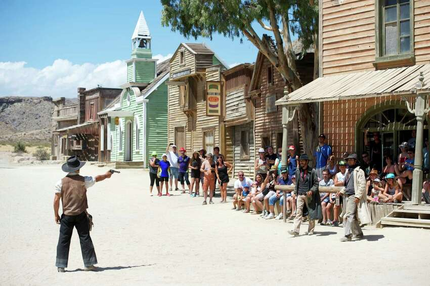 ALMERIA, SPAIN - AUGUST 20: Stunt actors perform during a show for tourists at Fort Bravo/Texas Hollywood on August 20, 2015 in Almeria, Spain. Fort Bravo Texas Hollywood, built in the 1960s in Almeria, Spain, is a western style set for films, which is also used for tourist tours. Originally used by film director Sergio Leone for 'A Fistful of Dollars', 'For a Few Price' and 'The Good, the Bad and the Ugly', which lead to the Spaghetti Western genre, today it is still used to shoot many different types of films. (Photo by Juan Naharro Gimenez/Getty Images)