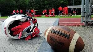 Foran High School football practice in Milford, Conn., on Friday Aug. 21, 2015.