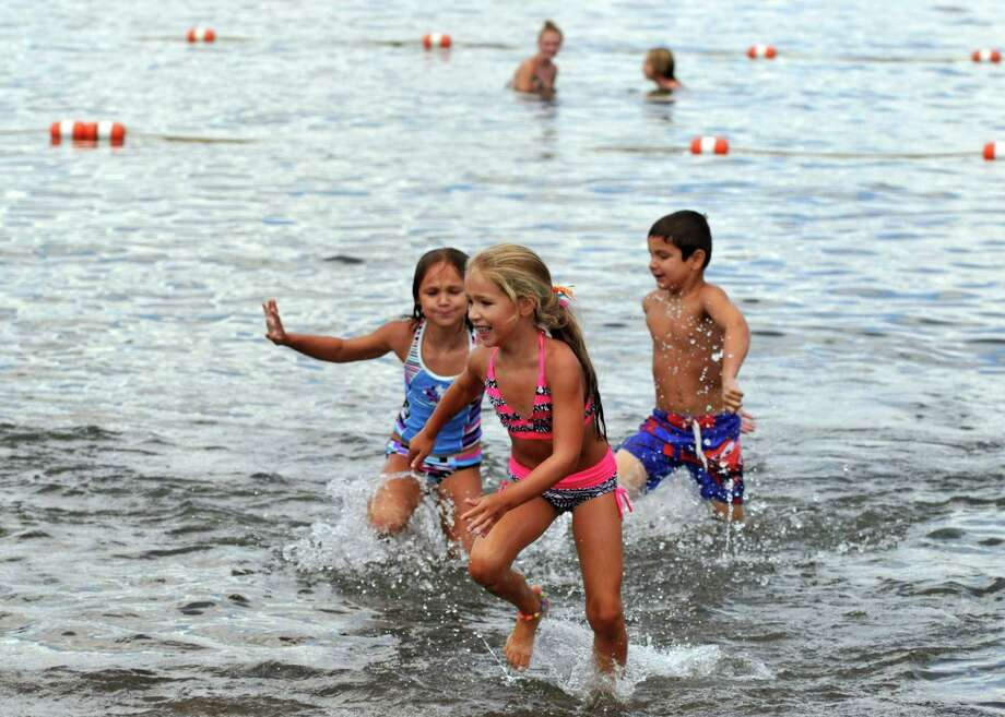 Children play in the water on Friday, Aug 21, 2015, at Million Dollar Beach in Lake George, N.Y. (Phoebe Sheehan/Special to The Times Union) Photo: PS