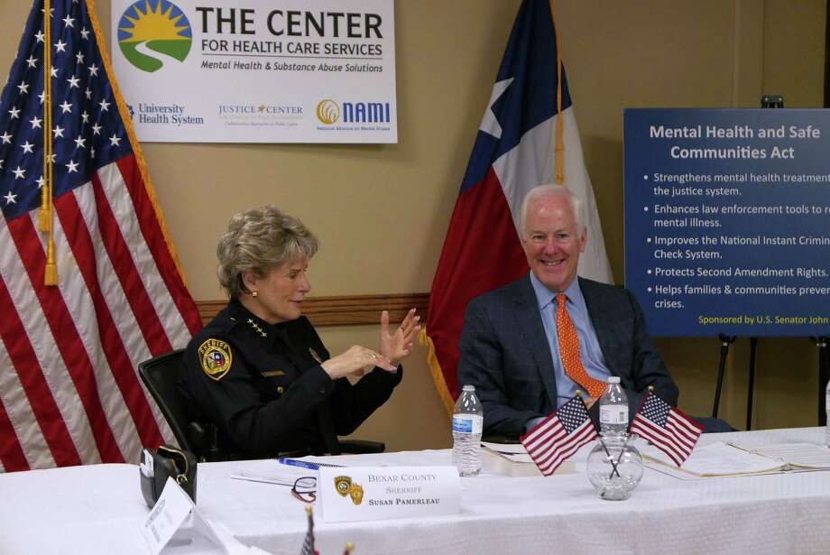 U.S. Senator John Cornyn (R-TX), right, and Bexar County Sheriff Susan Pamerleau speak at the Restoration Center at the Center for Health Care Services in San Antonio on Friday, Aug. 21, 2015. They spoke about  the county's nationally-recognized jail diversion and mental health programs and promoted Cornyn's bill, the Mental Health & Safe Communities Act. Photo: Billy Calzada, Staff / San Antonio Express-News / San Antonio Express-News
