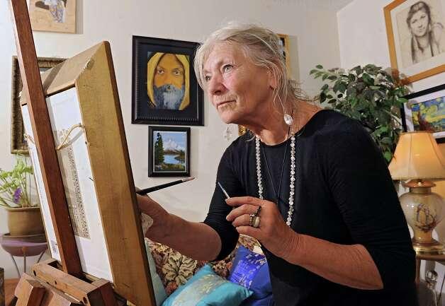 Ma Satprem Yeshe Dolma of Ikiera Divine Holistic Healing Arts is seen in her home on Wednesday, Aug. 12, 2015 in Clifton Park, N.Y. (Lori Van Buren / Times Union) Photo: Lori Van Buren / 00032967A