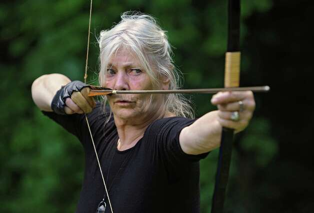 Ma Satprem Yeshe Dolma of Ikiera Divine Holistic Healing Arts practices her kyuodo archery in the back of her home on Wednesday, Aug. 12, 2015 in Clifton Park, N.Y. (Lori Van Buren / Times Union) Photo: Lori Van Buren / 00032967A