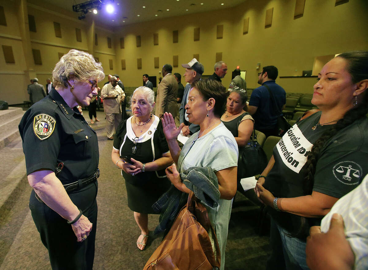 Bexar County Sheriff Susan Pamerleau listens to concerns about mental health issue at the county jail from Sandra Alvarado (center) as State Senator Jose Menendez leads a Forum on Civil Rights and Community Policing at the True Vision Church, 2826 Ackerman Road on August 20, 2015.