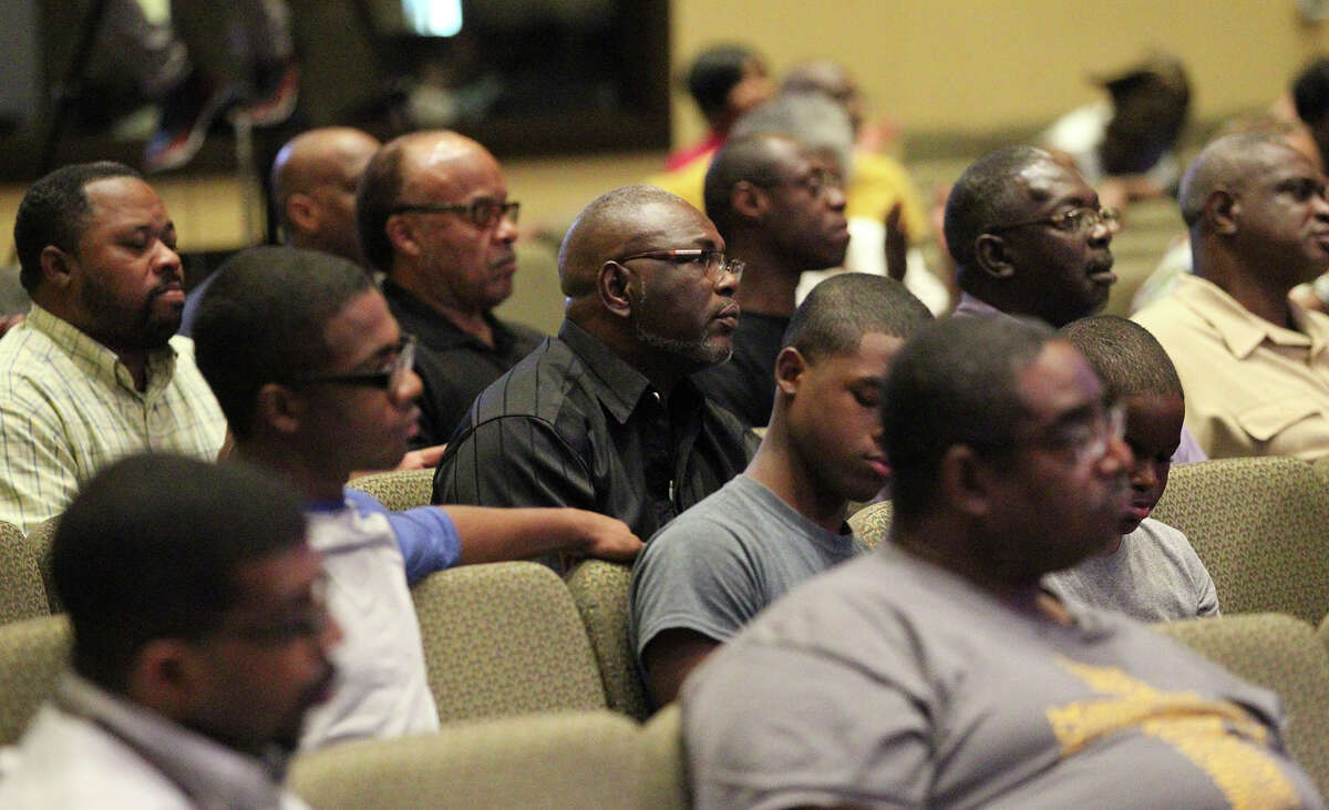 Community members listen quietly during the forum. Afterward, some said it was a positive first step, but better audience interaction was needed.