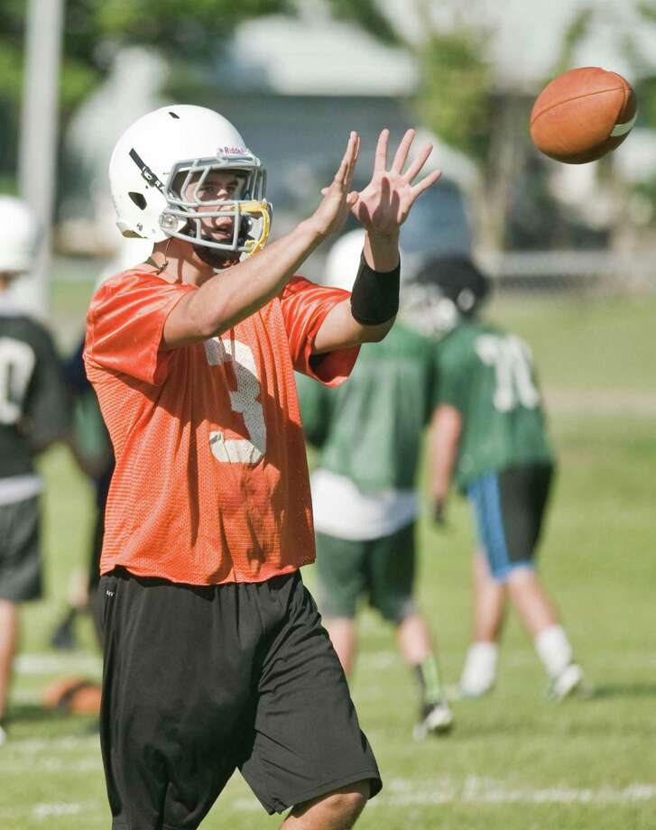 New Milford Green Wave quarterback Tyler Hansen working on a passing and receiving drill during football practice at New Milford High School. Friday, Aug. 21, 2015 Photo: Scott Mullin / For The / The News-Times Freelance