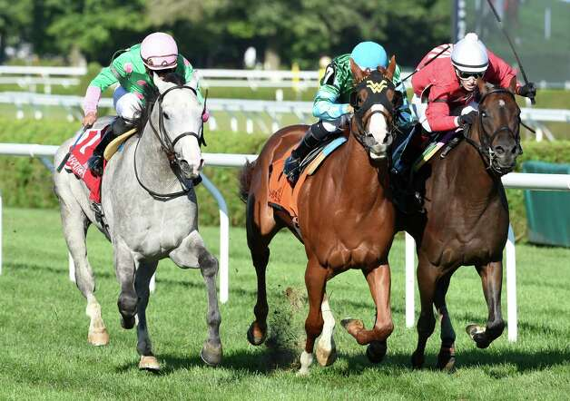 Too Discreet with jockey Joel Rosario, left moves ahead of #7 Bruised Orange with jockey Rafael Hernandez and #5 Don't Be So Salty ridden by Taylor Rice to win the first running of The Schenectady at the Saratoga Race Course Friday afternoon Aug. 21, 2015 in Saratoga Springs, N.Y.    (Skip Dickstein/Times Union) Photo: SKIP DICKSTEIN