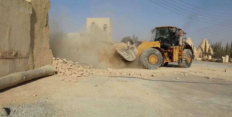 This picture, released late Thursday  by an Islamic State militant-affiliated website, shows a bulldozer destroying the Saint Eliane Monastery near the town of Qaryatain, Syria. The town, located in Homs province, was captured by Islamic State militants in early August.  Photo: Uncredited, HONS / Islamic State militant website