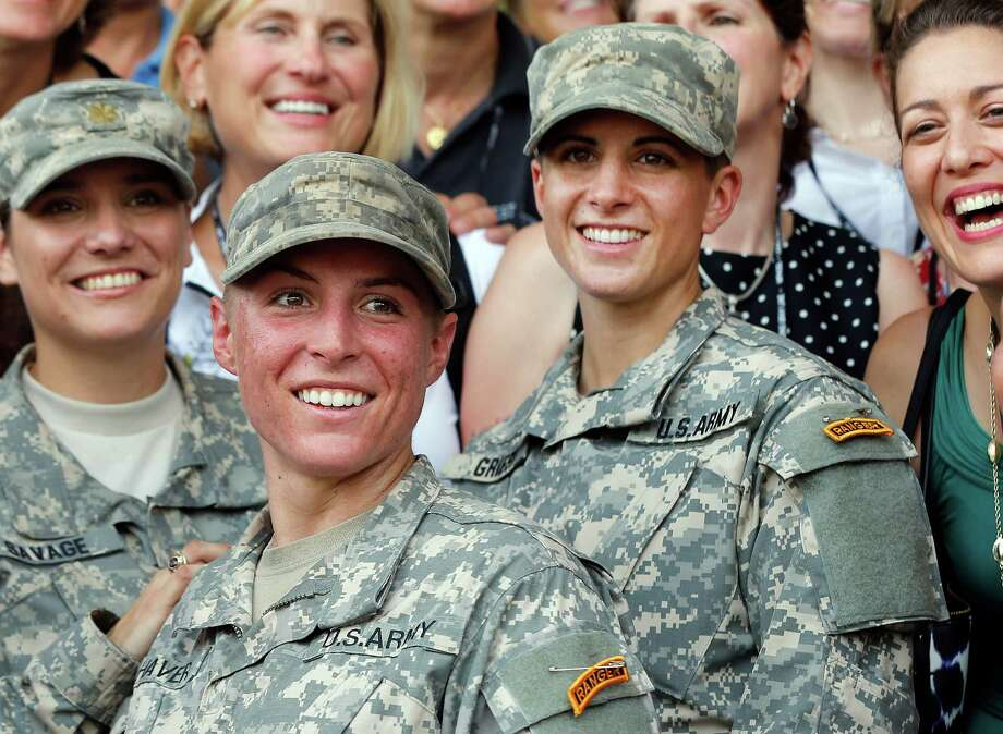 U.S. Army First Lt. Shaye Haver, center, and Capt. Kristen Griest, right, pose for photos with other female West Point alumni after an Army Ranger school graduation ceremony, Friday, Aug. 21, 2015, at Fort Benning, Ga. Haver and Griest became the first female graduates of the Army's rigorous Ranger School, putting a spotlight on the debate over women in combat.   (AP Photo/John Bazemore) ORG XMIT: GAJB103 Photo: John Bazemore / AP