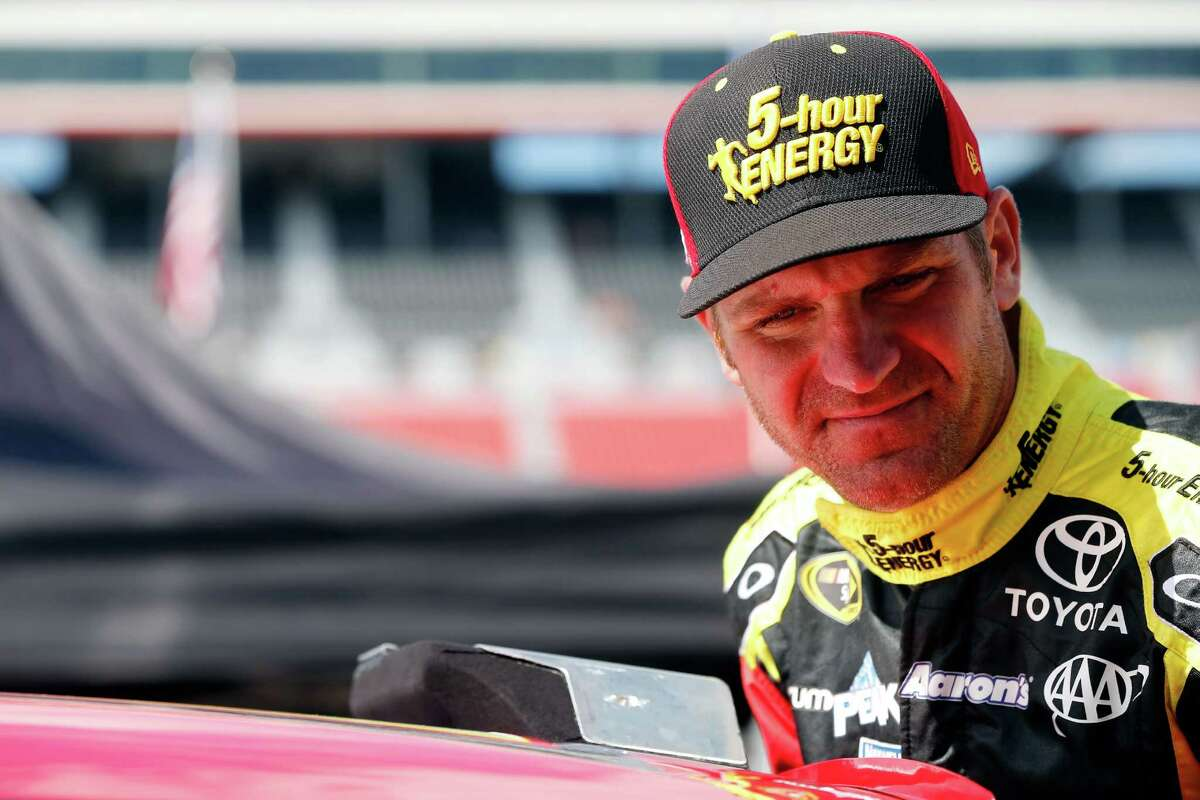 BRISTOL, TN - AUGUST 21: Clint Bowyer, driver of the #15 5-hour Energy Toyota, climbs into his car during practice for the NASCAR Sprint Cup Series Irwin Tools Night Race at Bristol Motor Speedway on August 21, 2015 in Bristol, Tennessee. (Photo by Brian Lawdermilk/Getty Images) ORG XMIT: 532290117