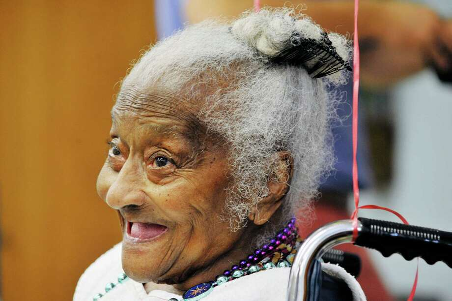Estelle Bailey, who turned 107 on Wednesday, celebrates her birthday at the Hudson Park Rehab & Nursing Center on Wednesday, July 1, 2015, in Albany, N.Y.   (Paul Buckowski / Times Union) Photo: PAUL BUCKOWSKI / 00032460A
