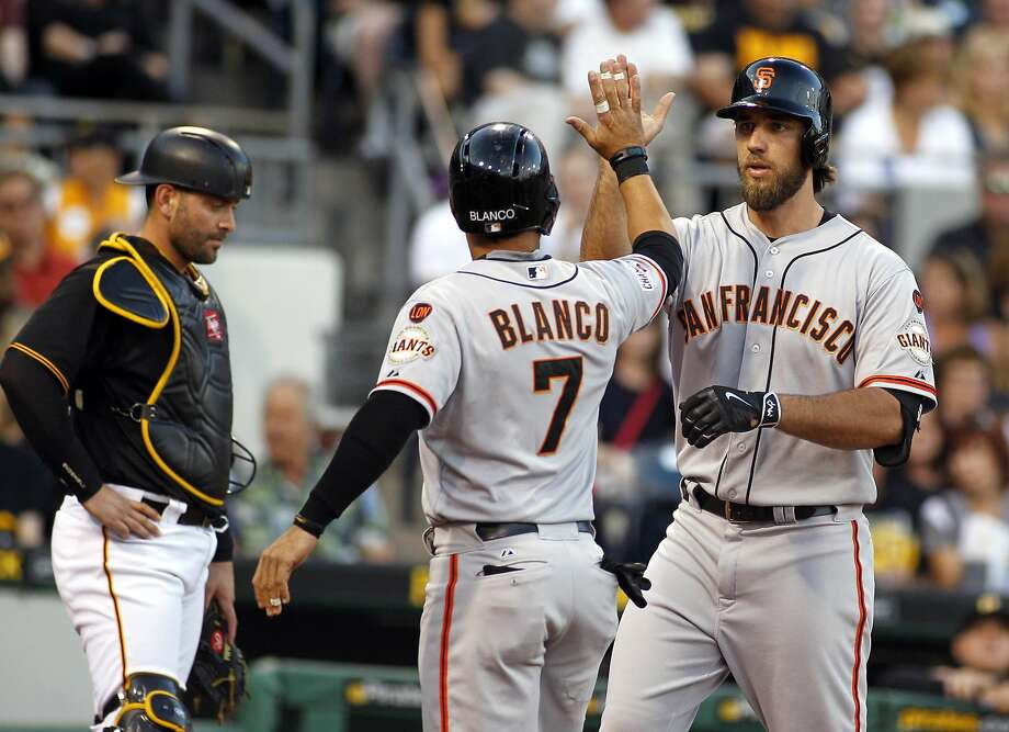 Madison Bumgarner is met at the plate by Gregor Blanco after the pitcher's homer Friday. Photo: Justin K. Aller, Getty Images
