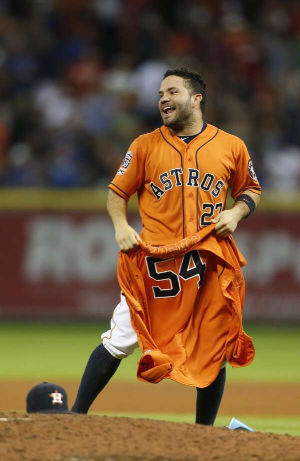 1. Do you know which colors the Astros sported before the team's latest switch back to orange and blue? Photo: Karen Warren, Houston Chronicle