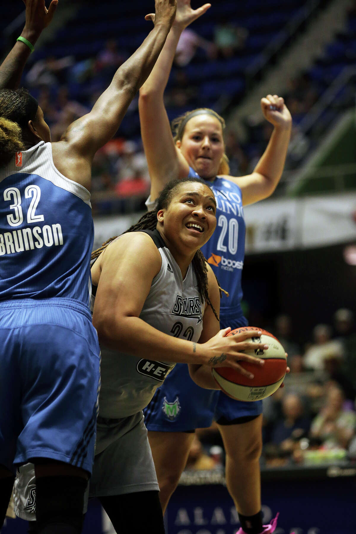 Danielle Adams challenges Rebekkah Brunson (32) and Tricia Liston under the boards as the Stars host the Minnesota Lynx at Freeman Coliseum on August 21, 2015.