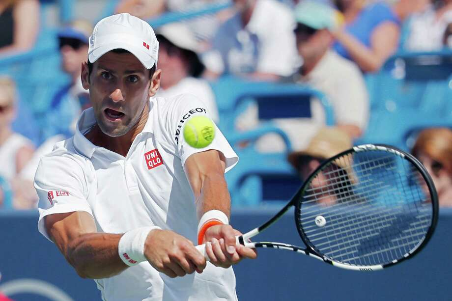 Novak Djokovic, of Serbia, returns the ball to Stanislas Wawrinka, of Switzerland, during a quarterfinal match at the Western & Southern Open tennis tournament, Friday, Aug. 21, 2015, in Mason, Ohio. (AP Photo/John Minchillo) ORG XMIT: OHJM105 Photo: John Minchillo / AP