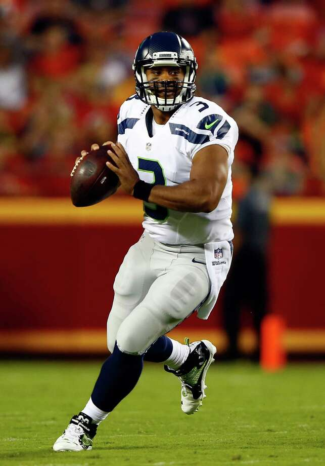 KANSAS CITY, MO - AUGUST 21:  Quarterback Russell Wilson #3 of the Seattle Seahawks passes during the preaseason game against the Kansas City Chiefs at Arrowhead Stadium on August 21, 2015 in Kansas City, Missouri.  (Photo by Jamie Squire/Getty Images) ORG XMIT: 565327673 Photo: Jamie Squire / 2015 Getty Images