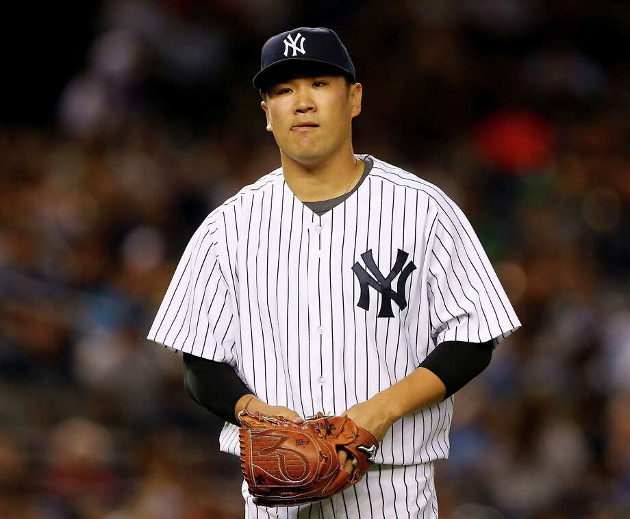NEW YORK, NY - AUGUST 21:  Masahiro Tanaka #19 of the New York Yankees heads back to the dugout after the third inning against the Cleveland Indians on August 21, 2015 at Yankee Stadium in the Bronx borough of New York City.  (Photo by Elsa/Getty Images) ORG XMIT: 538591169 Photo: Elsa / 2015 Getty Images