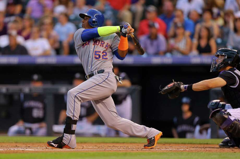 DENVER, CO - AUGUST 21:  Yoenis Cespedes #52 of the New York Mets hits a grand slam during the second inning against the Colorado Rockies at Coors Field on August 21, 2015 in Denver, Colorado. (Photo by Justin Edmonds/Getty Images) ORG XMIT: 538591167 Photo: Justin Edmonds / 2015 Getty Images