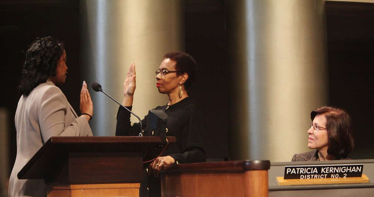 LaTonda Simmons, City Clerk (l to r) swears in City Attorney Barbara Parker as City Council member Patricia Kernighan watches from her seat at the City of Oakland Inauguration Ceremony in Council Chambers at City Hall on Monday, January 7, 2013 in Oakland, Calif.