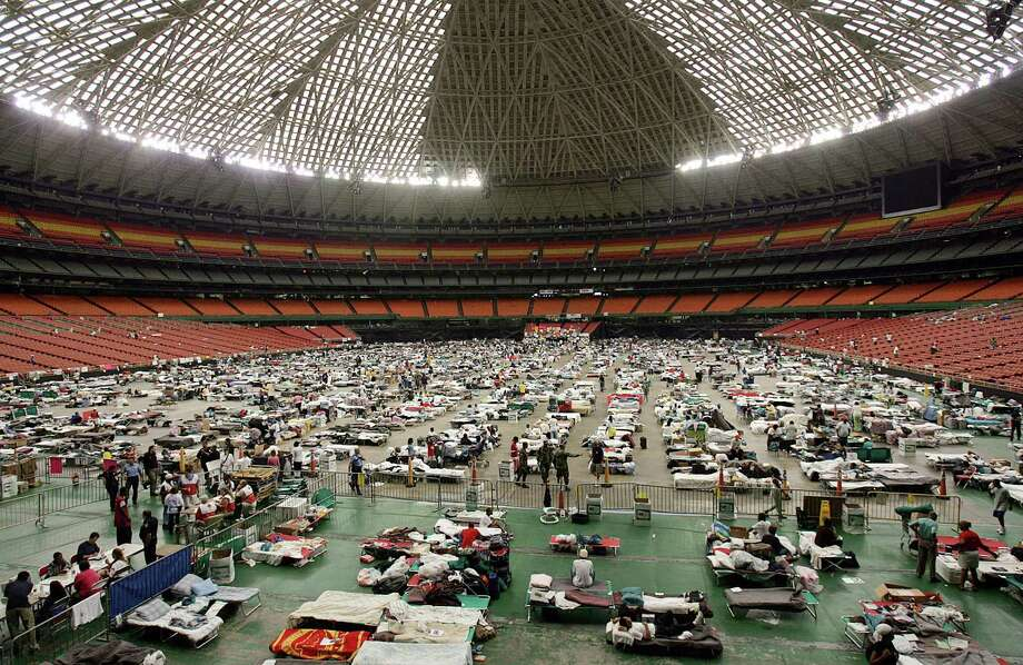 Thousands of New Orleanians fled their city after Hurricane Katrina's storm surge overtook the levees. For many, the Astrodome was their first respite.  Photo: MENAHEM KAHANA, Staff / AFP
