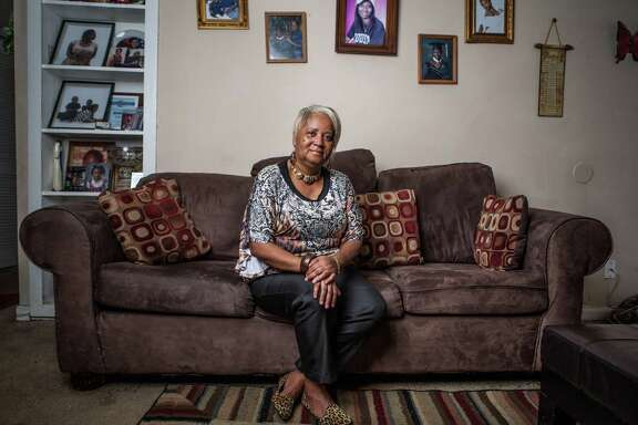 Reinita Jackson poses for a portrait in her home Thursday August 20, 2015. Jackson moved to Houston from New Orleans after being trapped in her home in neck-deep water for 5 days during Hurricane Katrina.